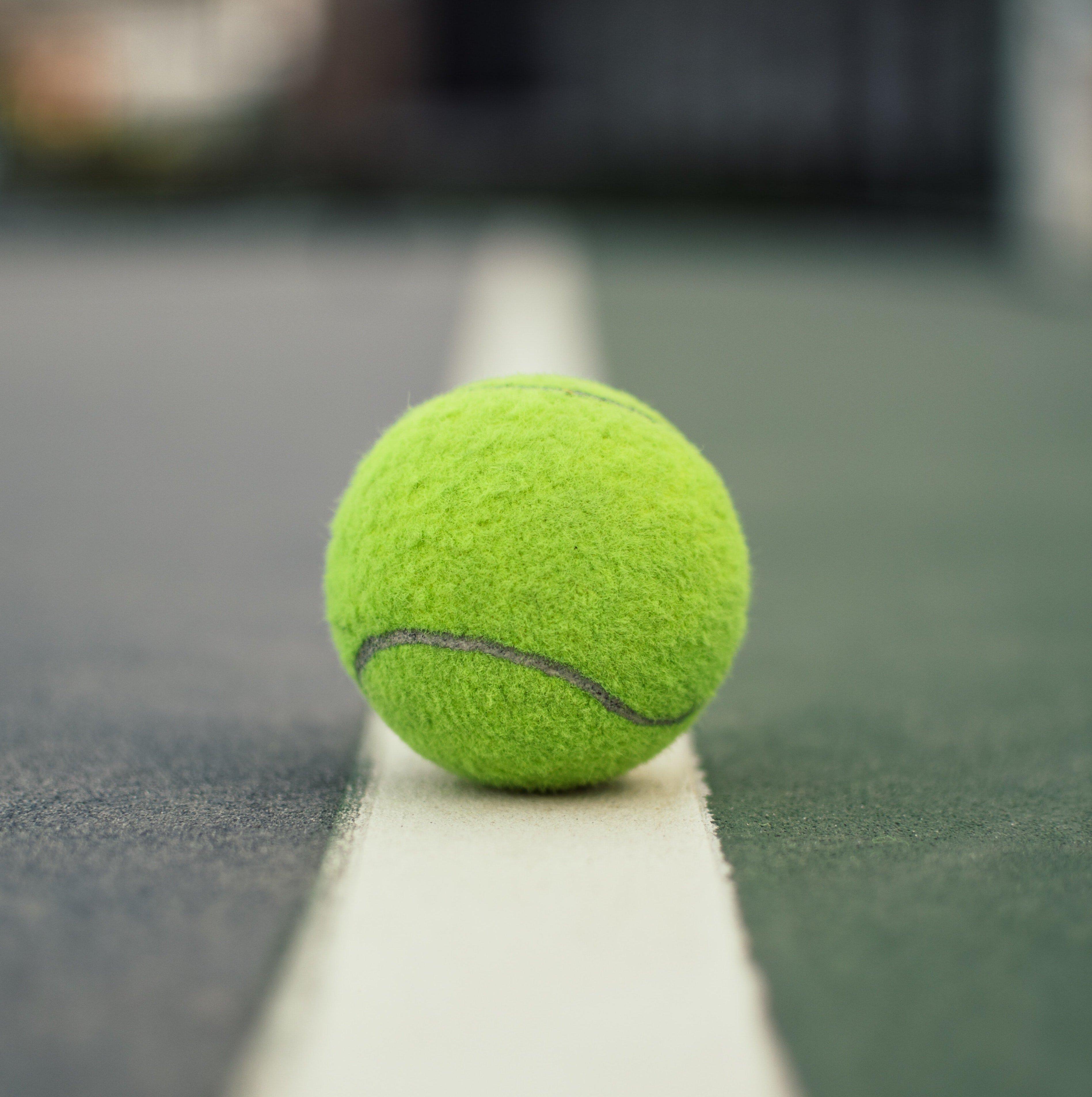 green-tennis-ball-on-court-1405355-1